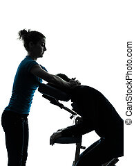 massage therapy with chair silhouette - one man and woman...