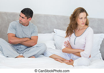 Couple ignoring each other - Mid adult couple ignoring each...