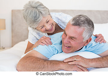 Senior couple lying in bed - Happy senior couple lying in...