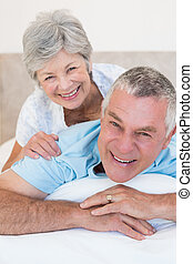 Loving senior couple relaxing in bed - Portrait of loving...
