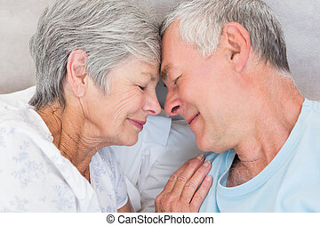 Romantic couple in bed - Romantic couple with head to head...