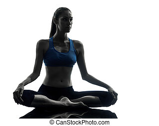 woman exercising yoga meditating silhouette