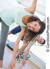 Woman stretching in health club - Portrait of happy fit...