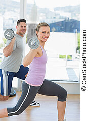 Happy woman and man exercising with