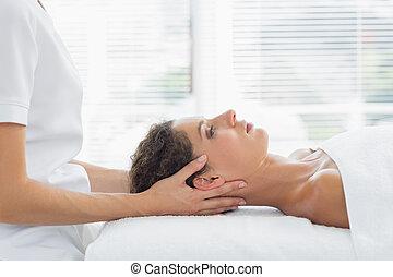 Woman receiving body massage in hea