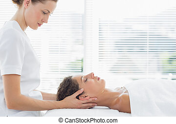 Beautiful woman receiving massage from physical therapist