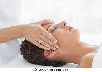 Woman receiving head massage - Side view of beautiful young...