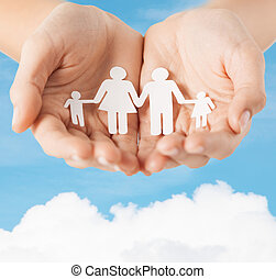 female hands with paper man family - family and relations...