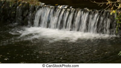 Water flowing down a waterfall into