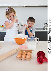 Children baking cookies in kitchen - Children baking cookies...