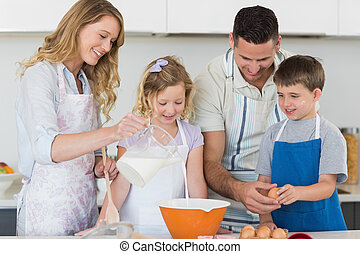 Family making cookies together in kitchen - Happy family...