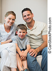 Family sitting together on sofa