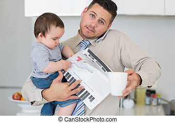 Portrait of father multi tasking in house - Portrait of...