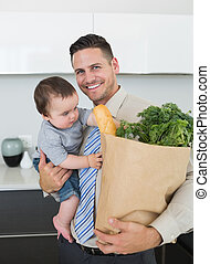 Businessman carrying groceries and - Portrait of happy...