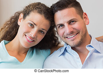 Smiling young couple at home