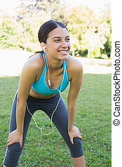 Sporty woman listening music - Young sporty woman listening...