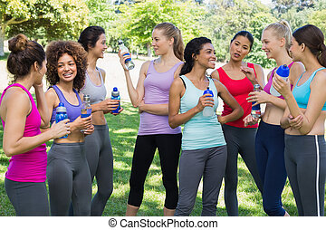 Sporty women communicating at park