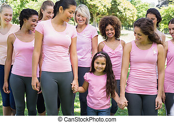 Group of females supporting breast cancer campaign - Group...