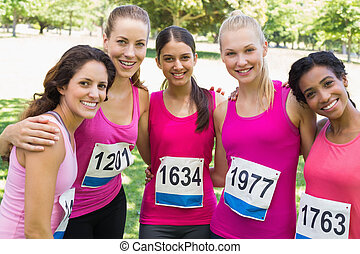 Confident female participants of breast cancer marathon...