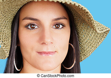 Portrait of woman with straw hat