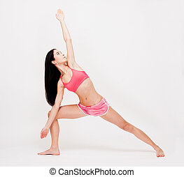 Yoga fitness. - Portrait of beautiful young brunette woman...