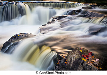 Bond Falls Whitewater - Flowing whitewater cascades over...