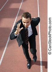 Business competition - Business man running on a track &...