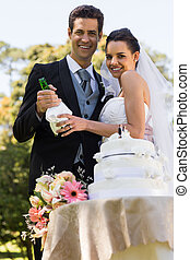 Happy newlywed with champagne bottl - Portrait of a happy...