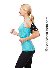 sporty woman running with smartphone - sport, excercise,...