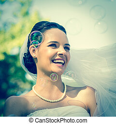 Close-up of beautiful bride looking - Close-up of a young...