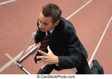 Business competition - Business man running on a track field...