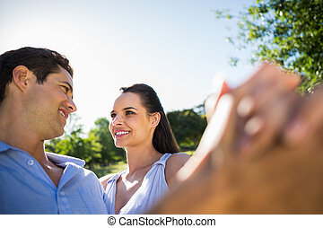 Loving and happy couple dancing at park - Close-up of a...