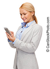 smiling woman looking at smartphone - business, internet and...