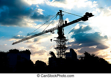 silhouettes of Industrial construction crane