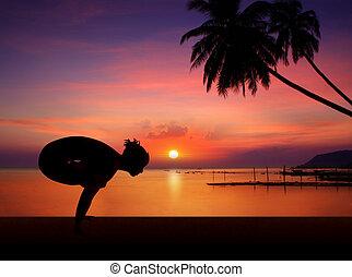 Yoga girl in sunset
