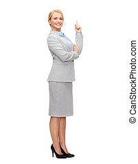 smiling businesswoman with her finger up - business and...