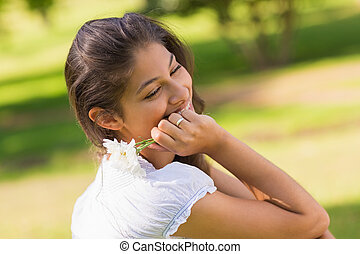 Close-up of a smiling woman holding flowers