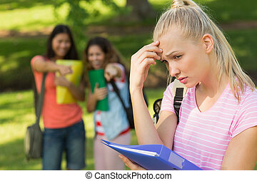 Female being bullied by group of students