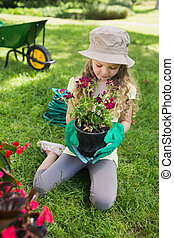 Little girl engaged in gardening - Full length of a little...