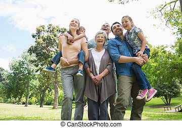 Cheerful extended family at park - Low angle view of...