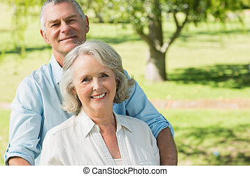 Smiling mature couple at summer park