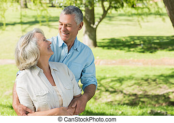 Loving and happy mature couple at park - Portrait of a...
