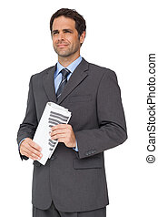Handsome businessman holding a newspaper on white background