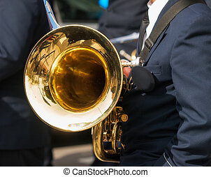 bass trumpet - Trumpeter of a brass band with a brass...