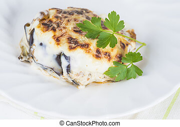 Traditional Greek moussaka served and decorated with a leaf...