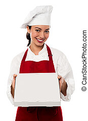 Here is your order sir. - Young female chef delivering pizza