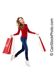 run for shopping - Happy young woman running with a lot of...