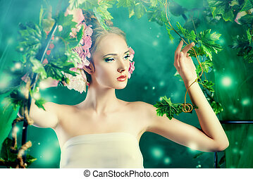 lady in garden - Beautiful young woman standing under an...