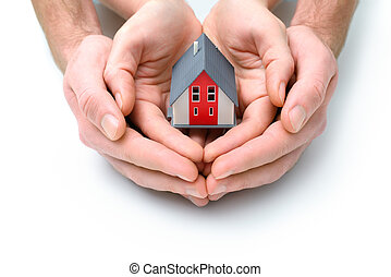 house in human hands - Human hands holdilg small model of...