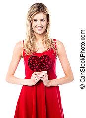 Teen girl holding valentine gift